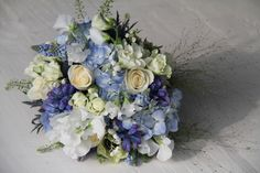 wedding bouquets in purple lavender blue and champagne | Blue Hydrangeas, Lily of the Valley, Blue Muscari, Blue Bells, Blue ...