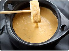 beer cheese fondue made with smoked gouda and Cheddar cheese. Very easy recipe. Yummm!