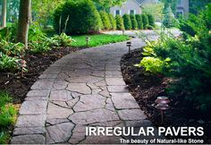 Made to withstand heavy foot traffic and climate changes, pavers come in many sizes, styles, colors and to match any exterior scheme. This walkway features Belgard pavers and trim. Mixing paver styles and textures offers a unique look. Flagstone Pathway, Outdoor Walkway, Paver Walkway, Front Walkway, Front Yard Landscaping, Walkway Ideas, Landscaping Ideas, Backyard Walkway, Patio Ideas