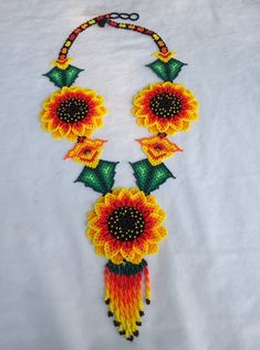 3 Flower Beaded Necklace crafted by a Huichol Indigenous family of Mexico. The Huichol are known mainly for their vision-based art and shamanic work. Handmade Beads, Handmade Jewelry, Necklace Packaging, Beaded Tassel Necklace, Gifts For Wedding Party, Beaded Flowers, Crystal Beads, Beadwork, Beading