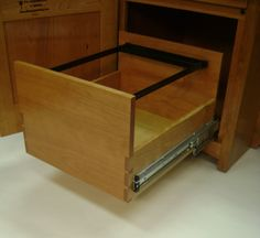 This file drawer features a hanging file frame that will accommodate both letter and legal sizes.