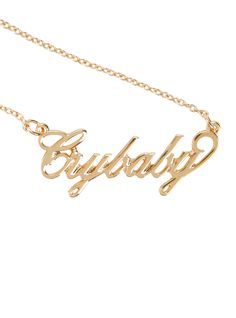 """Get your hands on this gold tone Melanie Martinez """"Crybaby"""" nameplate necklace, matching Melanie's very own! Now you can cry if you want to.       16"""" chain; 3"""" extender    Alloy    Imported"""