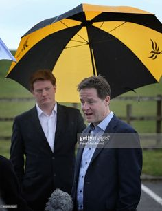 liberal-democrat-danny-alexander-stands-under-an-umbrella-as-party-picture-id468480628 (785×1024)