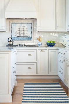 Add a range backsplash. The space between the stovetop and the vent hood presents a design opportunity — a chance to incorporate a ceramic work of art or a mosaic that stands out from the rest of the backsplash.