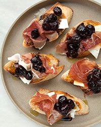 Crostini with Stewed Black Grapes, Prosciutto and Ricotta Salata Recipe on Food & Wine | try phyllo cups?