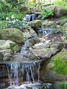 Stream spilling over rocks Backyard Stream, Garden Stream, Hillside Garden, Backyard Water Feature, Ponds Backyard, Pool Water Features, Water Features In The Garden, Pond Landscaping, Landscaping With Rocks