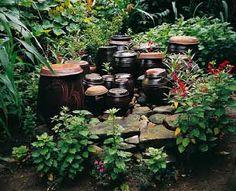 Jangdokdae (Korean: 장독대): Traditional earthen jars used for aging doenjang, gochujang and kimchi.