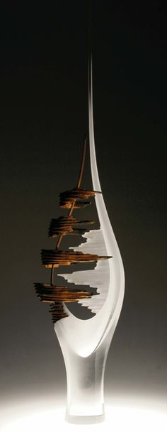 Alex Fekete / PRISM contemporary.  Blown and carved glass & fused steel.