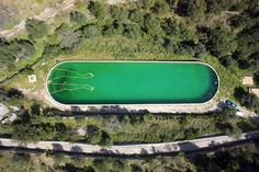 santiago morilla draws bathing man using floating pool tubes for invisible bath at ses artigues in alaró, mallorca, spain Street Installation, Spanish Artists, Land Art, Public Art, Surfboard, Landscape Design, Cool Art, Awesome Art, Bathing