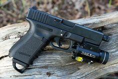 Glock with threaded barrel and Streamlight