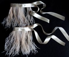 Ostrich feather ankle cuffs.