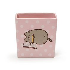 Fans of Pusheen can now keep track of pens and pencils with their favorite cat! This durable stoneware container from Our Name is Mud features Pusheen doodling