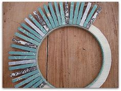 A better look at the clothespin wreath. The base is cardboard. Gotta love a freebie ! (from Make It Give It)