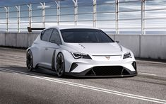 SEAT's new CUPRA e-Racer, which has just made its global debut at the Geneva motor show, is being claimed by the Spanish manufacturer to be the world's first electric racing touring car. The vehicle is the first touring car that complies with the […] Volkswagen, Seat Cupra, Automobile, Wallpaper Free, Car In The World, Car Wallpapers, Electric Cars, Car Ins, Motor Car