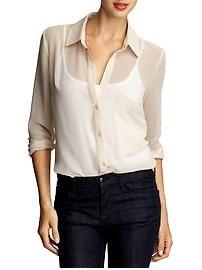 Sheer blouse under a suit...fabulous!