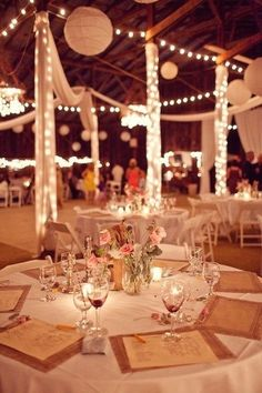 wedding decor. I like the lighted poles! Would be cute for the tent poles!
