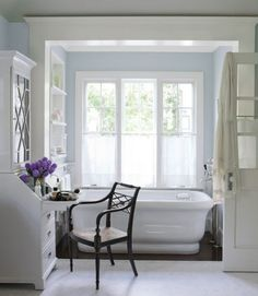 """I love bathrooms that feel like rooms rather than just a place to bathe,"" Smith says. ""They should inspire romance. This is an homage to the ceremonial bath, a place to relax and reflect and contemplate simple pleasures."" Instead of a built-in vanity, she used a George III — style secretary bookcase from Robert & Robert. The freestanding Empire tub is by Waterworks."