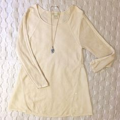 Sweet Silk Tunic Off-white or cream, very lightweight silk knit ribbed tunic with open crochet panels on sleeves and back. Bottom back panel of delicate chiffon Beautiful lines. Preowned but no spots or unraveling. Size large. Asoie Tops Tunics