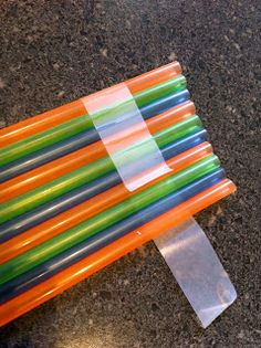 Children love to play instruments and there are many you can make at home. This is a simple wind pipe that children can make in just a few minutes. With the straws we had there was an opportunity to discuss patterns and order. Simply lay out a line of sticky take with the sticky part …