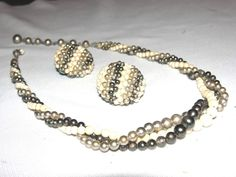 PRICE $19.50 - Vtg Japan triple twisted 3 Strand Faux Cream Silver Black Pearl Necklace Earring #JapanFlower Leaf Brooch Pin Earrings ..... We are TOP RATED * POWER Sellers on EBAY * Selling WORLDWIDE. Visit us at our EBAY STORE * 4COOLSTUFF2BUY with any questions or items for sale.
