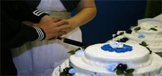 Colton and Ashley Yount cutting cake.