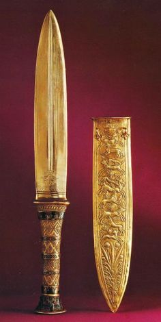 Gold dagger, from the tomb of King Tutankhamun, Carter # 256dd; 31.9 cm; blade 20.1 cm; Egyptian Museum, Cairo. Two similar daggers were found in Tutankhamun's tomb, one with a gold blade (in image 26) and the other with an iron blade. Gold daggers were reserved for the nobility, but bronze or copper daggers were used from the Old Kingdom on in Egypt.