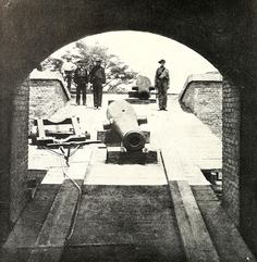 Confederate soldiers posing on a ramp leading from the sally port into the interior of Fort Barrancas with two cannon barrels which are about to be installed on the ramparts of the fort in Pensacola, Florida, 1861. By Jay Dearborn Edwards. From Miller's Photographic History of the Civil War.