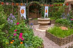 At RHS Chelsea Flower Show in the Magna Carta Garden  www.waterwillows.com  Tel: 0845 020 4225