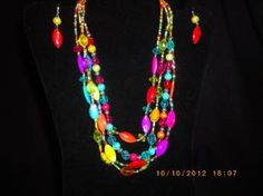 Wild Necklace and Earring Set with all the Fall and Winter Colors!  SANTA SAYS: FREE SHIPPING!  Please take the time to visit my other listings on Copious, Style.ly and Yardsellr.  You will find sophisticated well made jewelry at cheap prices. You will be pleased! Also, you can find me on Tophatter and Outbid auction sites.