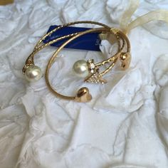 { New } Gorgeous heart arrow pearl bracelets Brand new beautiful Bella & jack set of three bangles, arrow with faux diamonds, heart bracelet, and pearl bracelet. The perfect arm candy, gold tone. Carved bangles, very eye catching. Reasonable offers welcome, bundle & save Jewelry Bracelets