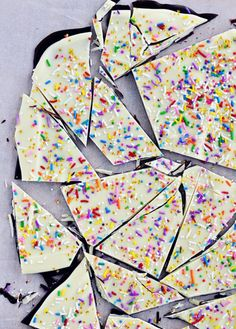 Crazy Good Cake Batter Bark | This candy is super easy and makes for a tasty homemade gift.  Dark chocolate and white chocolate are layered and garnished with rainbow sprinkles for a pop of color.  The cake batter flavor comes from the addition of white cake mix.