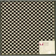 Millchek - Double cloth in a black and white checkerboard pattern. The warp and weft threads are black and white and intersect to form solid areas of color.