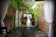 I love the use of curtains in this indoor / outdoor space. 85 Coffee House / 85 Design.