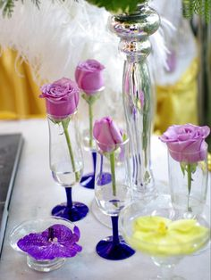 For a fairytale effect, place a single rose in a glass or vase. Then disperse multiple glasses around each table.