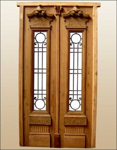 Amazing double door fully restored made in solid mahogany wood. This door has been fully restored by our in-house professionals and the condition after a hard job is amazing. It comes prehung and behind the iron inserts you have hinges glass frame to open and close. Ask for additional services such as finish and installation.