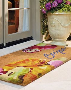 Brighten things up with blooming flowers and a French welcome!