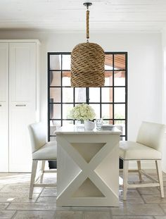 island, bench barstool seating, light fixture, cabinetry, french doors, white on white