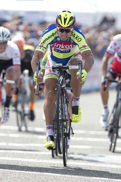 Peter Sagan (Tinkoff-Saxo) half wheelies/half slams his wheel up and down in relief of victory (Tim de Waele/TDWSport.com)