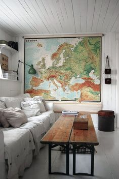 love everything about this room - the sofa, the long double bench/table, the map, the shelves, green light...a cozy space