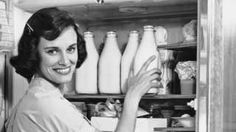 Housewife taking milk out of the fridge