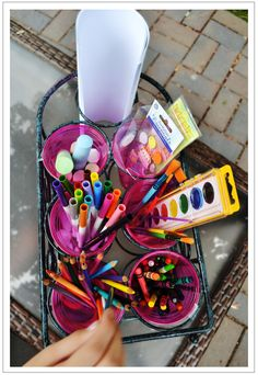 Repurpose a thrifted wine rack from Goodwill into an art caddy for kids! DIY, summer, kid activities