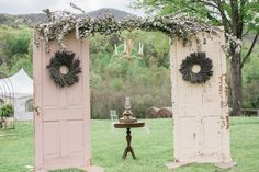 Erica's dad constructed a vintage door ceremony arch, which was decorated with a hanging vintage chandelier. Wreaths of lavender on each of the doors with eucalyptus draped across the top completed the rustic style.