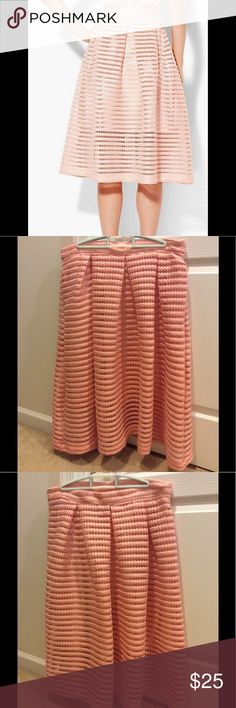 """New York & Company Ribbed Flare Skirt NTW. Excellent condition, never worn. Ribbed flare plated skirt in the color """"pink melon"""". Full length of skirt is 26 1/2 inches. Side zipper with pockets on each side. See pictures for details. New York & Company Skirts"""
