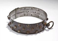 Antique dog collar belonging to 'Nelson the Newfoundland' who rescued a drowning man in the 18801 Melbourne floods. Inspection has revealed it was once plated and 'shone like silver'.