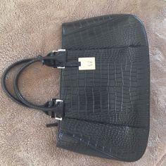 Etienne Aigner Black Genuine Leather Handbag Black genuine leather purse. Top closes by a zipper. Three separate compartments inside. Silver hardware. Gently used still in good condition ! Etienne Aigner Bags Shoulder Bags