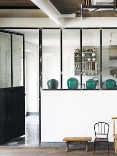 Elle Decor Italia // These look alike our turquoise Friendship Jars, love how they're showcased in the window panels. MIX Furniture S La Brea // mixfurniture.com // blog.mixfurniture.com