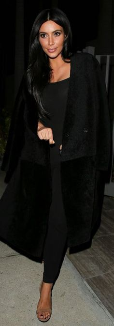 Who made  Kim Kardashian's black coat and tan suede sandals?