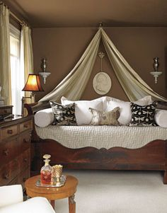 Tented Bed: What an easy way to cozy up your bedroom in any season! Use a heavier tent for fall and winter, and a breezier tent for summer! Love the antique dresser pictured here, too.