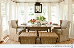 Bin ottomans, monochromatic walls and drapes, keeping the window seating low.      Original post: Simple and Stunning: 15 Farmhouse Dining Room Designs