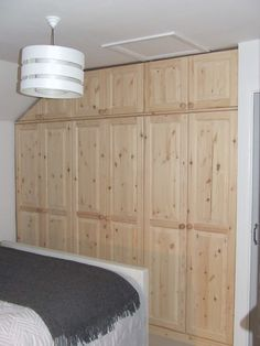 A recent picture from one of our customers of a finished fitted pine wardrobe that we had made for them: http://www.pinefurniturecornwall.co.uk/search.asp?types=Fitted+Wardrobes